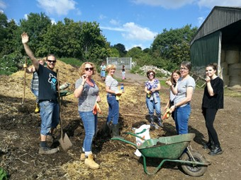 Volunteers from Emersons Green Primary School create a compost heap