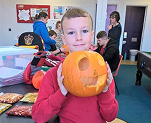 Carving pumpkins at Playlink