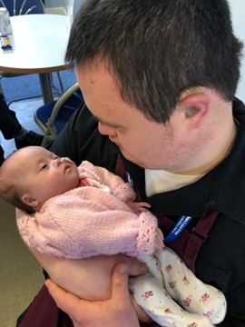Brandon trainee Dan has a cuddle with baby Elsie Sky
