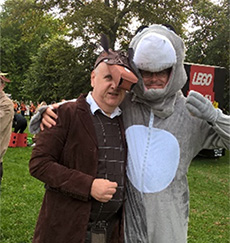 Neil at a charity walk with a gentleman he supports