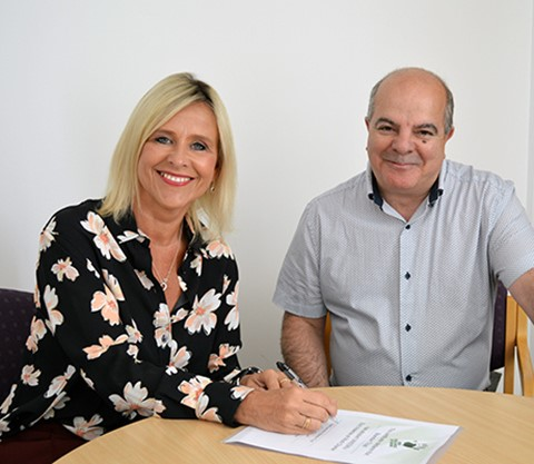 Sue Porto signs Unison's End Violence at Work Charter