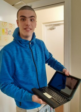 Aiden and his donated tablet