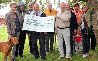 Steve Manning presents cheque to Elm Tree Farm manager Keily Elvin